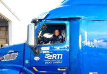 Sharae Moore sitting in her newly purchased bright blue truck